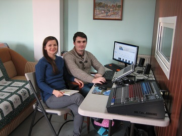 Silviu and Laura at work in the radio room